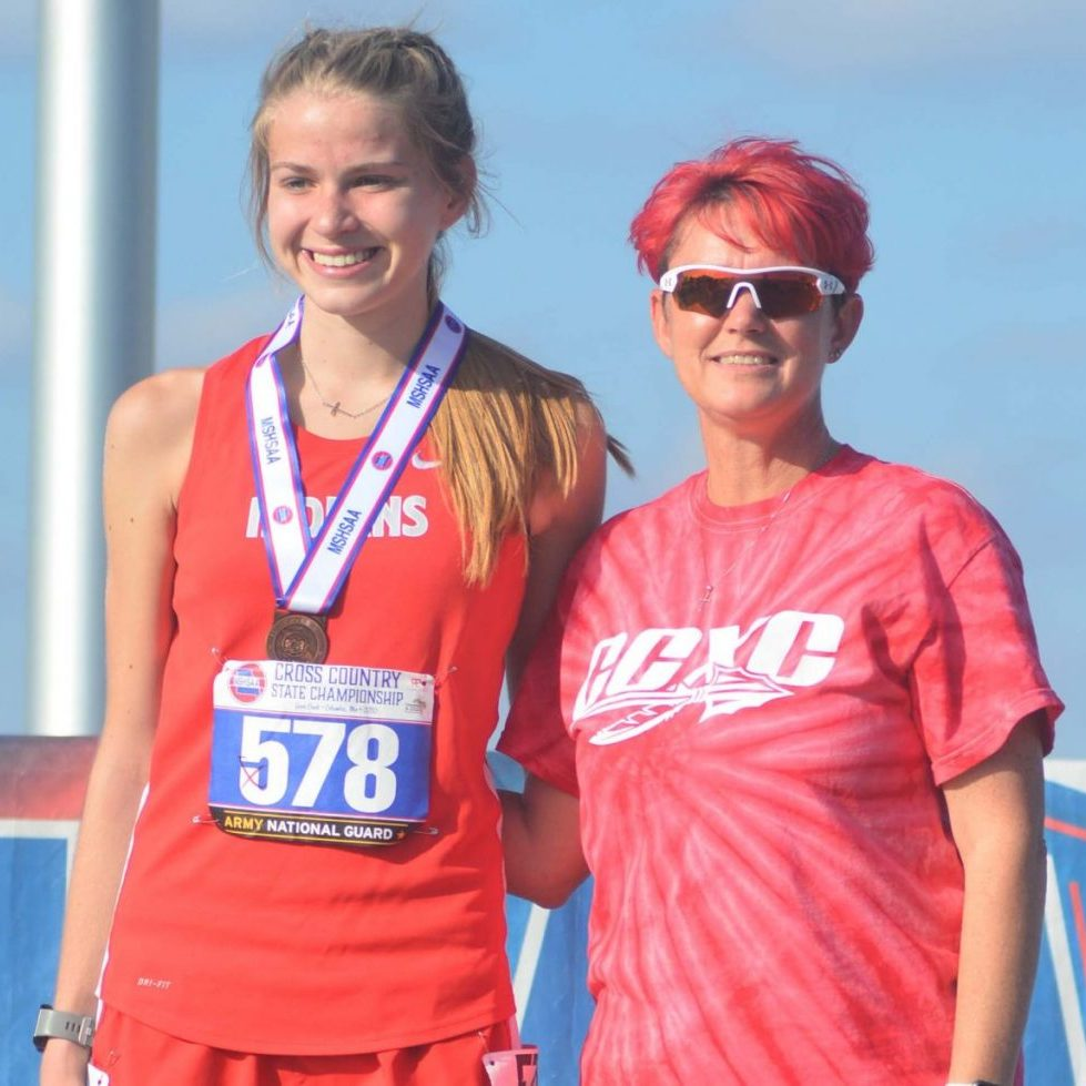 Grace Buschling had a 4th place finish, with a time of 20:18.40