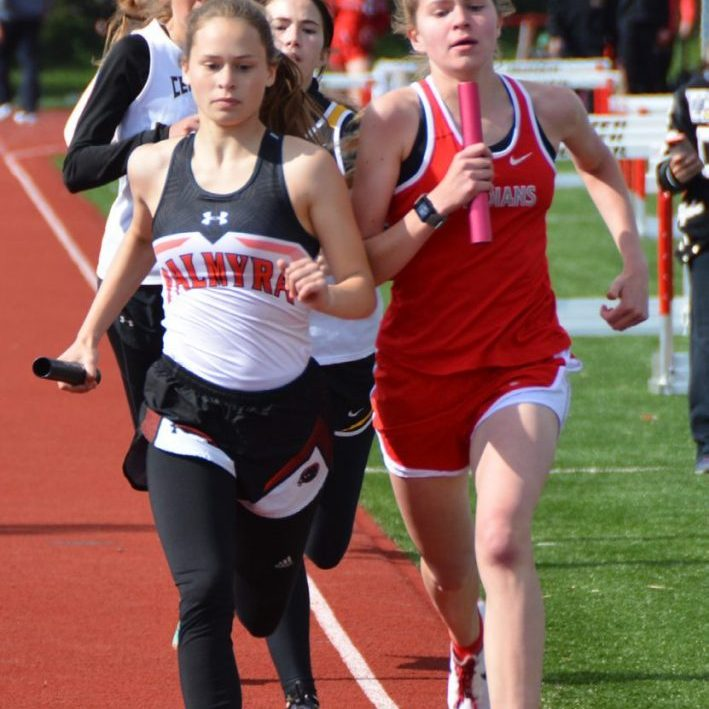 Grace Bushling duels with a Palmyra runner in the 4x800 relay at the CCC meet.