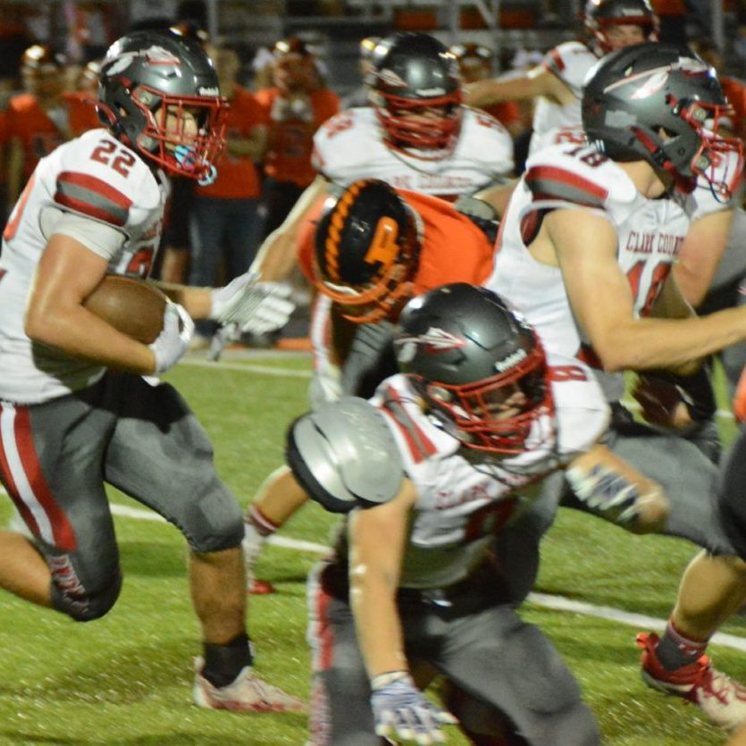 With Drew Holsted and Jonny Shinn blocking, Wyatt Randall carries the ball for Clark County at Palmyra.
