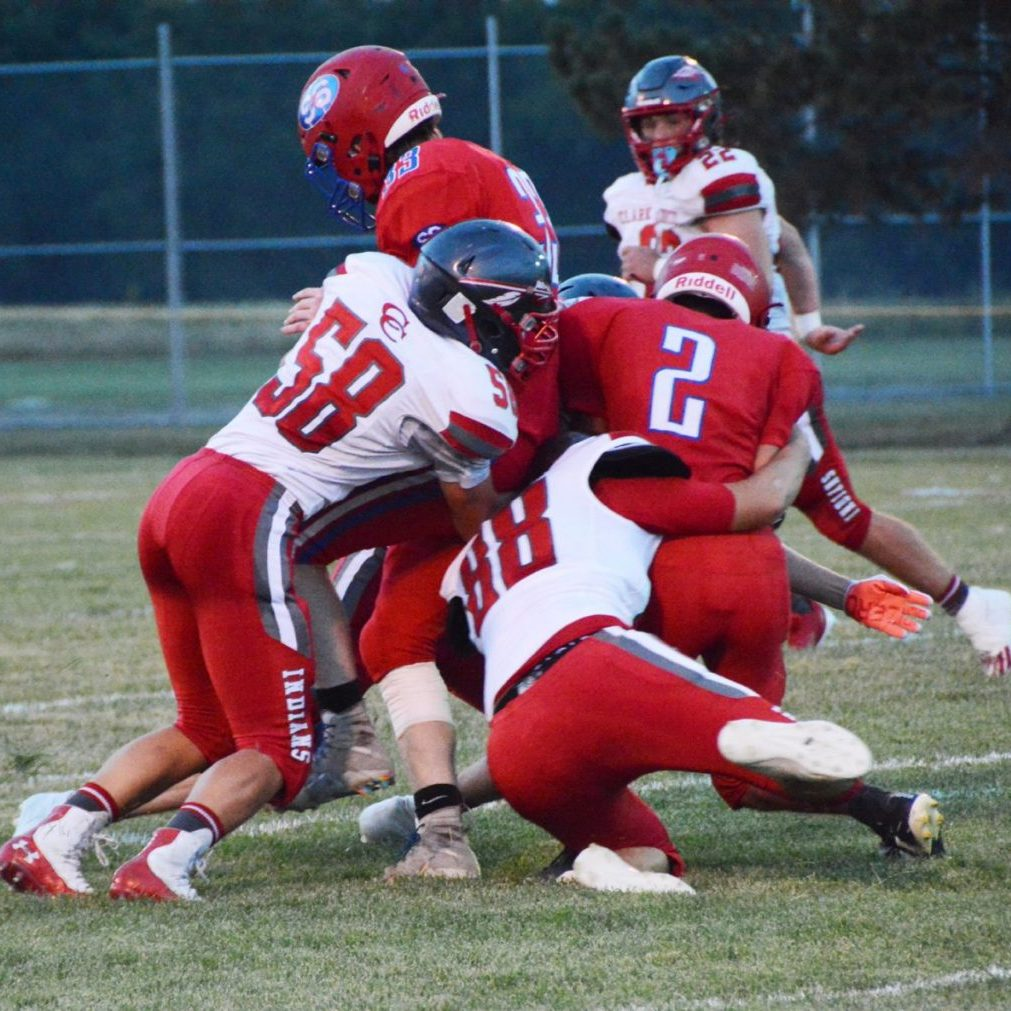 Tristan Pitford and Nate Brown bring down South Shelby's Wyatt Owens.