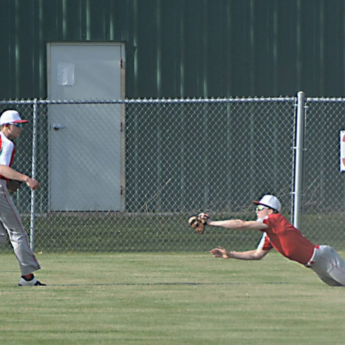 Drew Holstead makes a diving catch deep in left center field on Monday evening.
