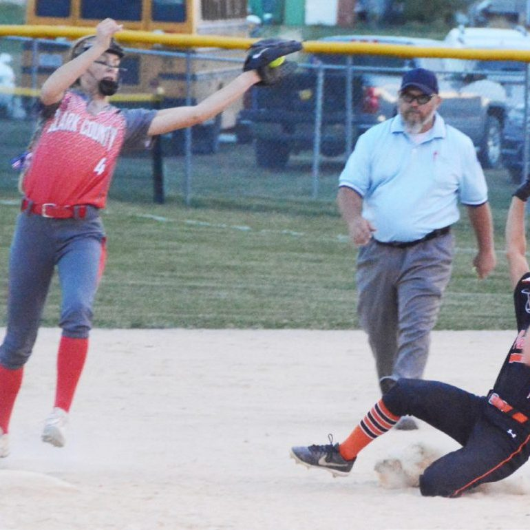 Hope Ross takes a high throw and gets her foot down on second base to pick off a steal attempt by a Palmyra baserunner.