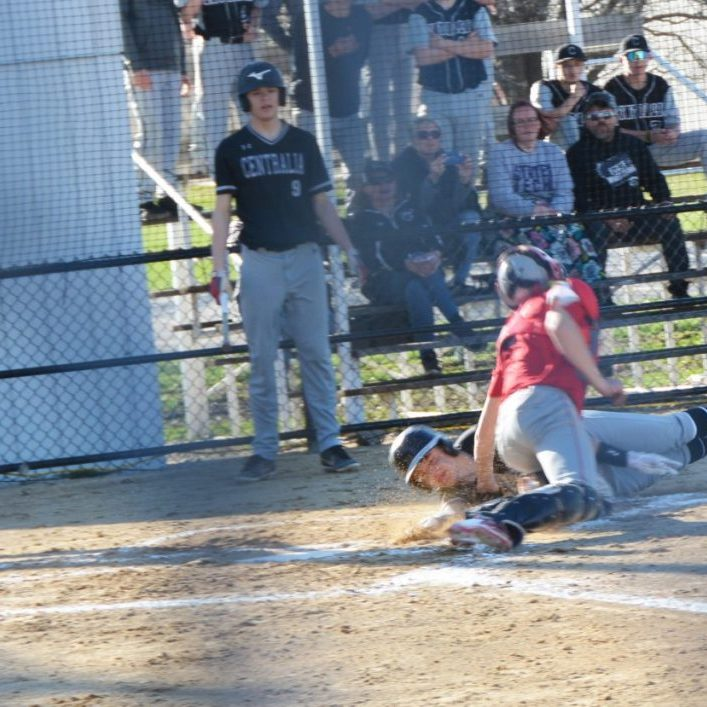Carter Briscoe tags a Centralia runner at home in Monday's Clarence Cannon Conference matchup.