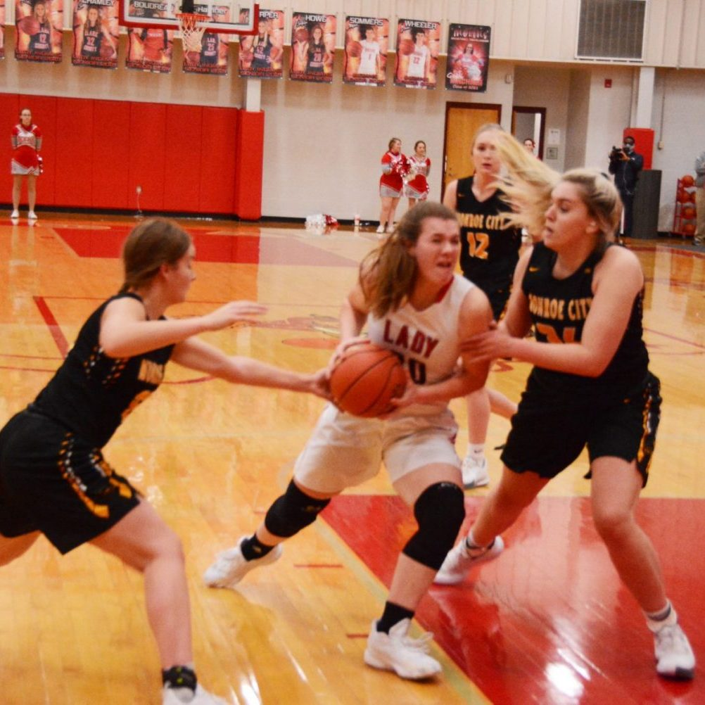 Brooklyn Howe fights for two points against Monroe City.
