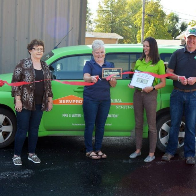 On Thursday, October 22, The Kahoka/Clark County Chamber of Commerce welcomed a new business member to the community, SERVPRO of Hannibal, with a ribbon cutting ceremony.  Pictured are (left to right) Staci Smith-board member, Bev Laffoon-board member, Cindy Smith-SERVPRO, Heather Temple-SERVPRO, Jamie Harmon-board member and Melissa Bevan-board member.
